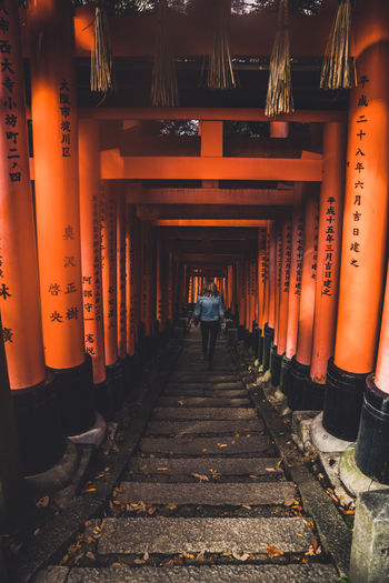 Japan Japan Shrine Shrine Architectural Column Architecture Built Structure Day Full Length In A Row Men Orange Color Outdoors People Real People Rear View The Way Forward Travel Destinations Two People Walking