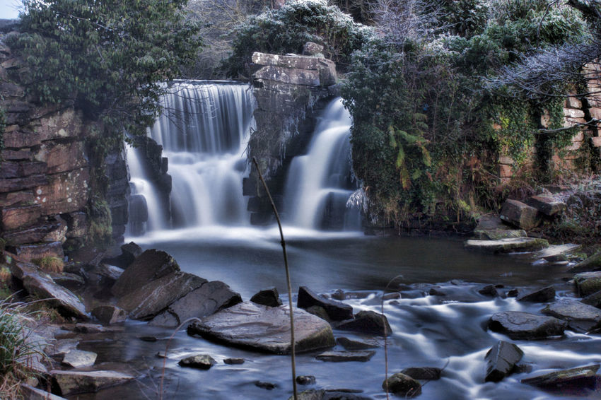 Beauty In Nature Blurred Motion Falling Water Flowing Flowing Water Forest Land Long Exposure Motion Nature No People Outdoors Penllergare Valley Woods Plant Power Power In Nature Purity Rainforest Rock Rock - Object Scenics - Nature Solid Tree Water Waterfall