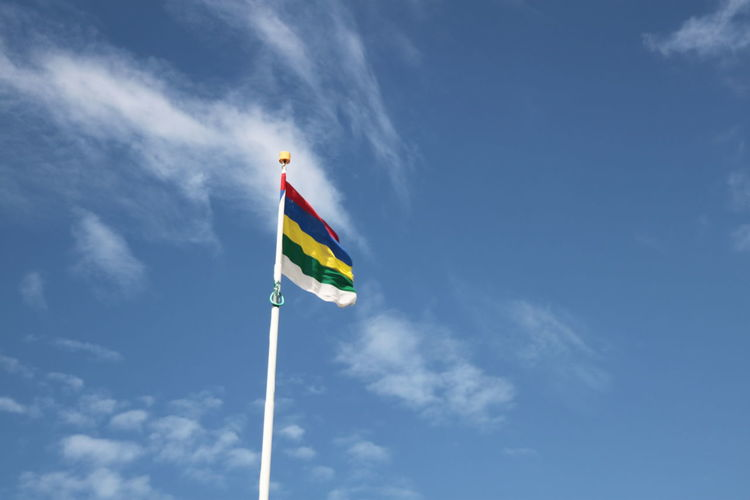 Low Angle View Of Colorful Flag Against Sky