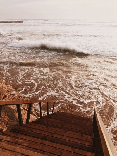 High tide and sunny day. Sea Water Beach Wave Land Wood - Material Horizon Over Water Beauty In Nature Motion Nature Horizon Tranquility No People Outdoors Tranquil Scene Scenics - Nature