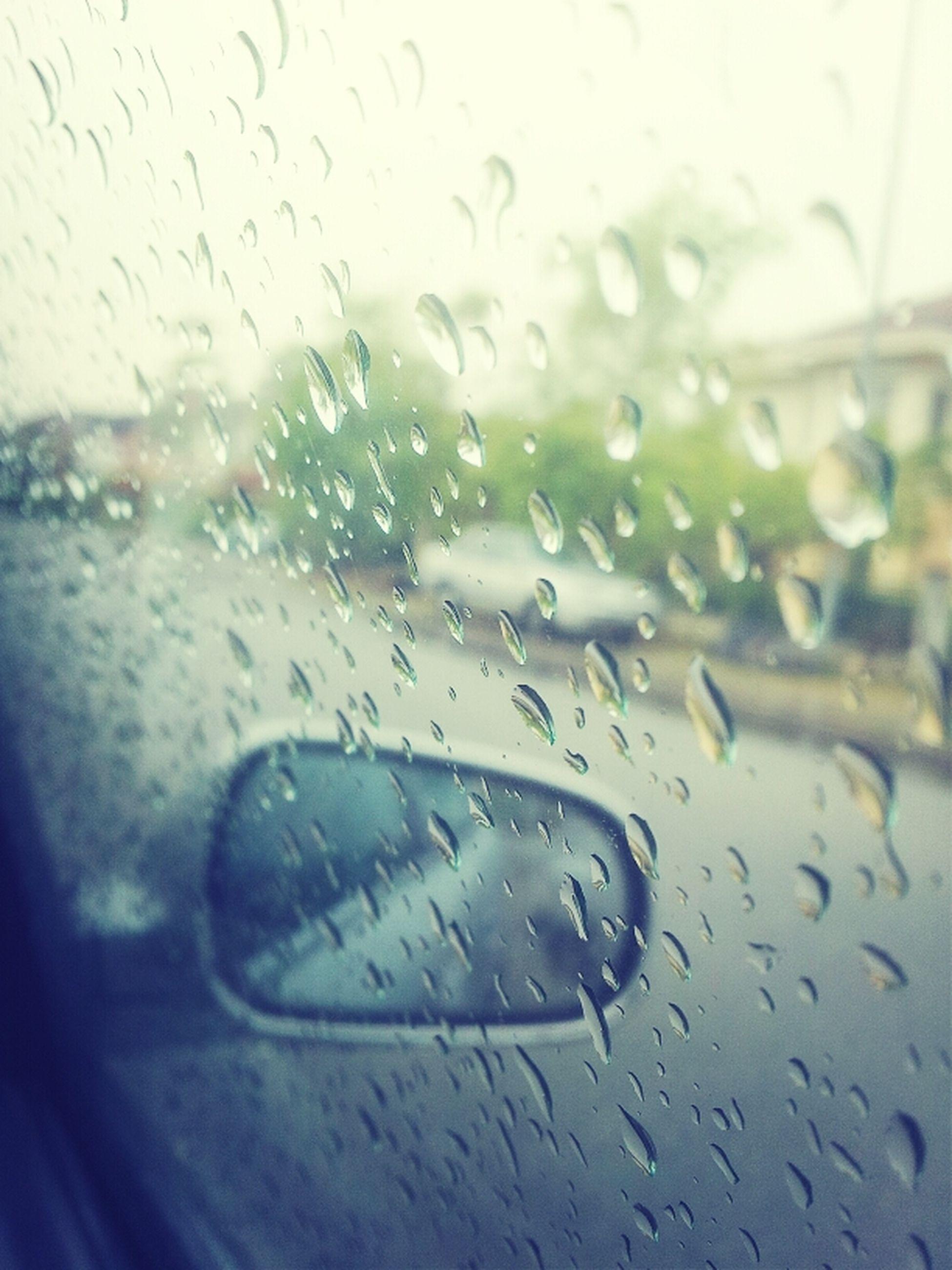 drop, window, transportation, transparent, glass - material, wet, rain, mode of transport, water, car, vehicle interior, land vehicle, raindrop, weather, indoors, car interior, season, windshield, close-up, glass