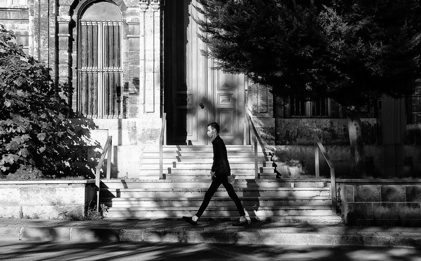 Man walking by building in city
