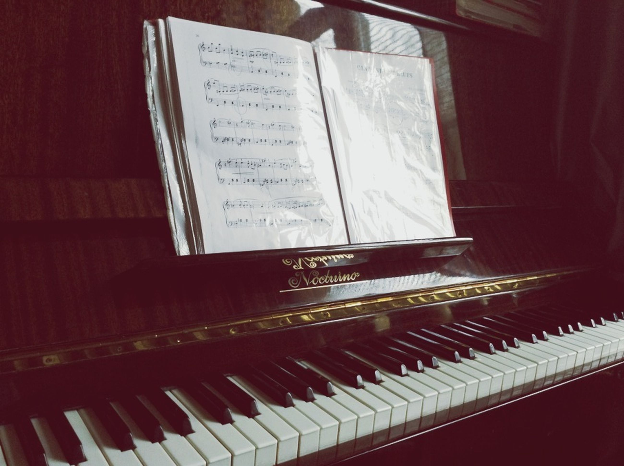 indoors, music, musical instrument, piano, arts culture and entertainment, technology, close-up, book, communication, table, text, high angle view, musical equipment, no people, piano key, chair, absence, wood - material, home interior, education