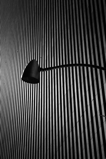 Low angle view of electric lamp on wall