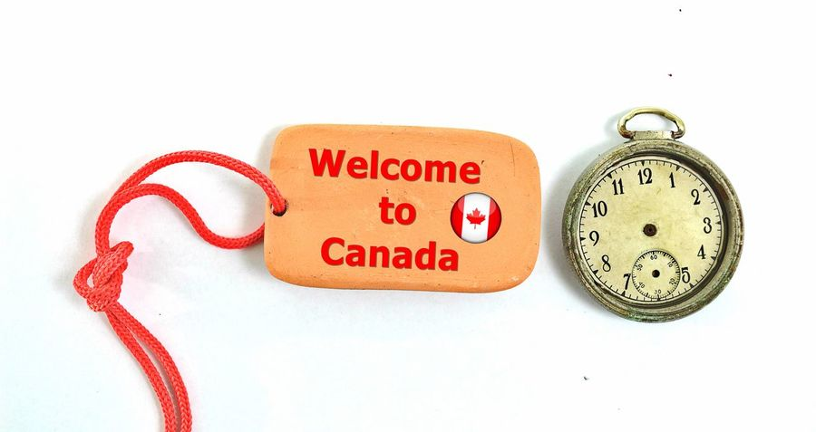 welcome to canada Welcome To Canada Canada Clay Clock Clock Face Close-up Communication Cut Out Indoors  Minute Hand No People Old-fashioned Pottery Studio Shot Text Time White Background
