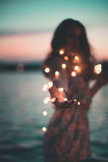 Real People Gesturing Focus On Foreground Outdoors One Person Leisure Activity Lifestyles Illuminated Women Sunset Water Sea Sky Human Hand Close-up Nature Young Women Young Adult Day People