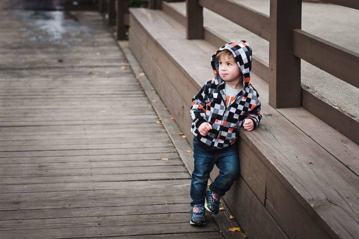 Such a cool kid! EyeEm Gallery Eyemphotography Copy Space EyeEm Selects Childhood Child One Person Full Length Wood - Material Boys Males  High Angle View Day Casual Clothing Footpath Outdoors Real People Warm Clothing Innocence Jeans Offspring Leisure Activity