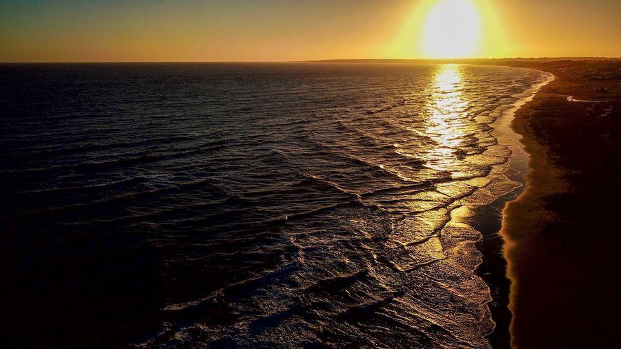 Sea Water Sunset Sky Scenics - Nature Beauty In Nature Horizon Horizon Over Water Tranquility Nature Tranquil Scene No People Land Sunlight Beach Idyllic Sun Reflection Wave Outdoors