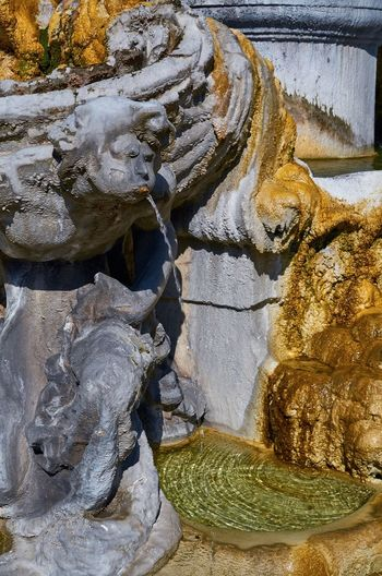 Quartiere Coppedè, Rome Italy Rome Quartierecoppedè Coppedè Stone Fountain Art Sculpture Statue Water Pool Flowing Water ArtWork Stonework No People Close-up Textures And Surfaces