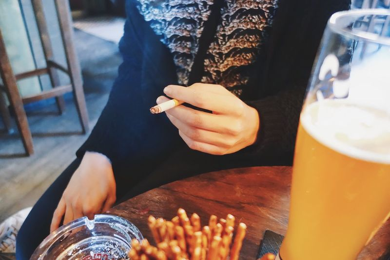 Food And Drink Human Hand Lifestyles Holding Bad Habit Drink One Person Human Body Part Close-up Cigarette  Smoking Bar Ashtray  Unhealthy
