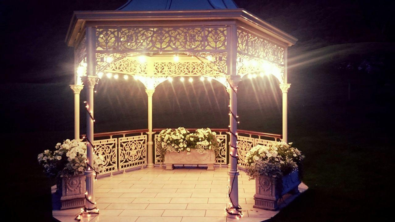 Illuminated Gazebo In Park At Night