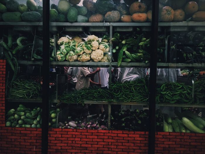 Vegetables in store seen through window glass