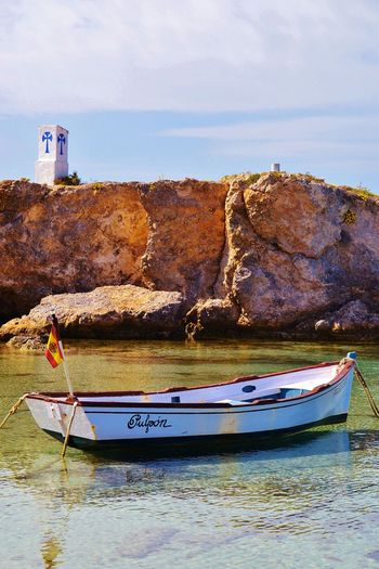 Relaxing Tied Boat Fisherman Town Reflection Sea Boats Boat Islandlife Alicante Tabarca's Island Island Island Life Tabarca Alicante, Spain Beach Life Beach Photography Place Of Interest Place Tranquility Scene Awesome Enjoying Life Relaxing Beach Tranquility