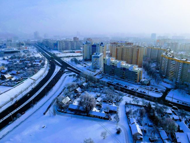City Building Exterior Architecture Cityscape Built Structure Transportation No People Street Road High Angle View Building Mode Of Transportation Aerial View Winter Sky Cold Temperature Outdoors Snow Office Building Exterior Nature