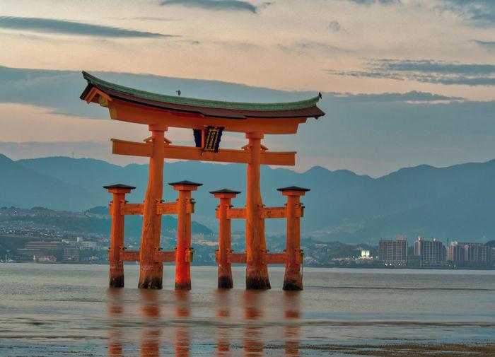 Itsukushima Shrine Japan Japan Photography Miyajima Architecture Beauty In Nature Building Exterior Built Structure Day Hiroshima Mountain Mountain Range Nature No People Outdoors Place Of Worship Religion Scenics Sea Sky Spirituality Sunset Travel Destinations Water Waterfront