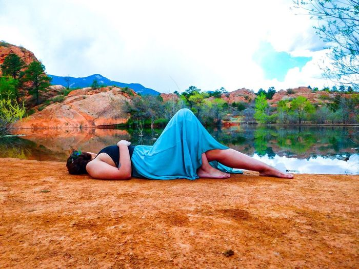 Girl Laying by the Lake The Great Outdoors With Adobe Beautiful Nature Beauty In Nature Beautiful Colorado Springs Colorado Coloradogram GodsOwnCountry Nature Photography Mountains And Sky Reflection Pond Lake