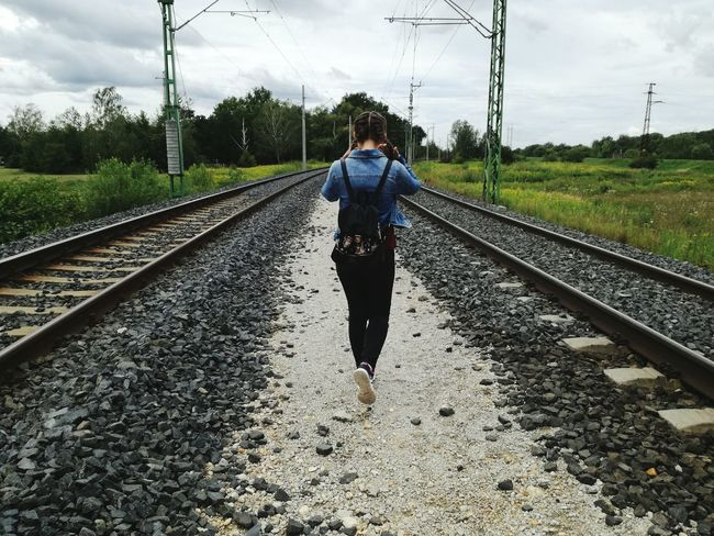 Girl Power Railroad Track Rail Transportation Cloud - Sky Transportation One Person Sky Walking Full Length The Way Forward Tree Electricity Pylon Day Outdoors One Girl Only Travel Backpack Long Longhair Nature Beauty In Nature Grass Lifestyles Real People Girl