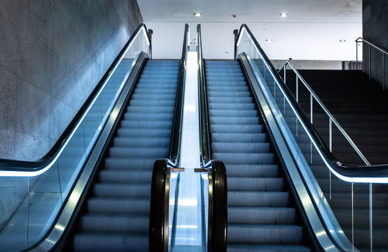 Low angle view of escalators in building
