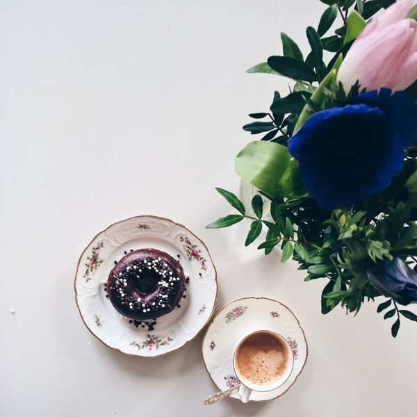 A Chocolate donuts and coffee Arrangement Close-up Tulips Decoration Directly Above Flower Pot Freshness Growing Growth High Angle View Indoors  Ranunkel  Spring Flowers Plant Potted Plant Ripe Still Life Table Variation Donuts Donut Chocolate Coffee Coffee Time Coffee And Sweets