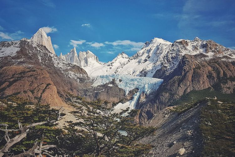 | Remembering Patagonia | Dreaming PATAGONIA Patagonia Argentina Travel Nature Clouds And Sky Dramatic Sky Wood Mountain Snow Tree Winter Snowcapped Mountain Mountain Peak Cold Temperature Sky Mountain Range Landscape Pine Woodland Pine Tree Coniferous Tree Pine Wood Rock Formation 17.62° My Best Photo