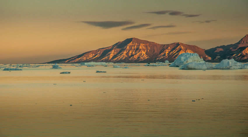 Arctic Beauty In Nature Cold Temperature Greenland Icebergs Landscape Mountain Nature No People Outdoors Scenics Sky Sunset Tranquil Scene Tranquility Water Arctica Arcticsummer Arctic Light Arctic Nature Midnight Sun Breathing Space Perspectives On Nature