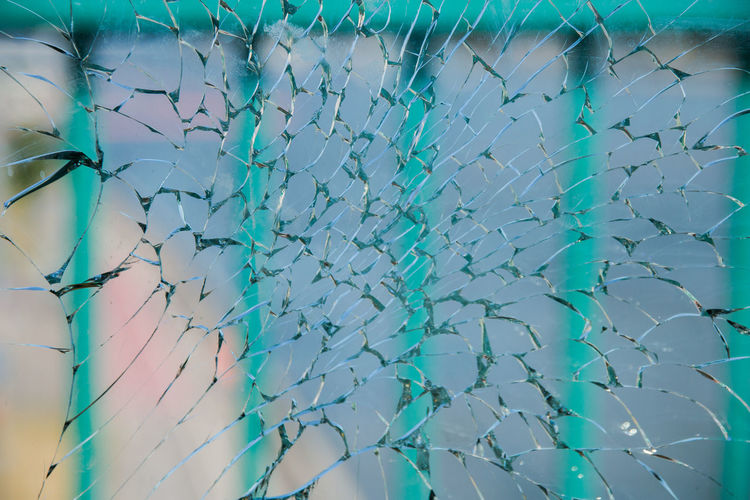 broken glass School Of Fish Cracked Built Structure Window Green Color Damaged Close-up Turquoise Colored Transparent Large Group Of Animals Day Shattered Glass Low Angle View Nature Group Of Animals Backgrounds Glass - Material Pattern Full Frame Blue No People Outdoors Sky
