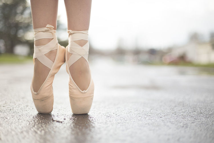 A ballerina in ballet shoes in the street. Artist Beautiful Beautiful Nature Dance Dancing Road Ballet Concert Dancer Feet Ground Lower Half Pavement Pink Color Shoes Street Toes The Week On EyeEm