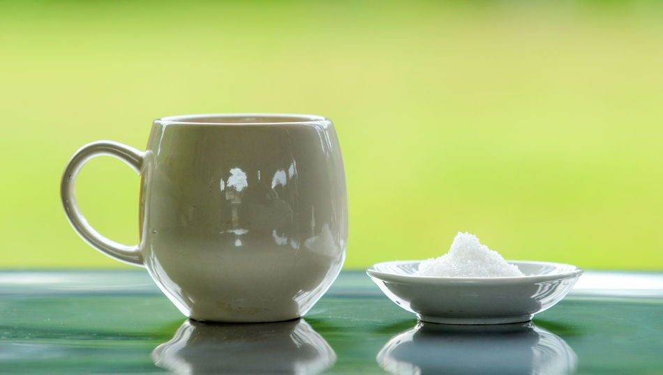 Bowl Ceramics Close-up Coffee Cup Crockery Cup Drink Focus On Foreground Food Food And Drink Freshness Green Color Indoors  Mug No People Reflection Refreshment Still Life Table Tea Cup