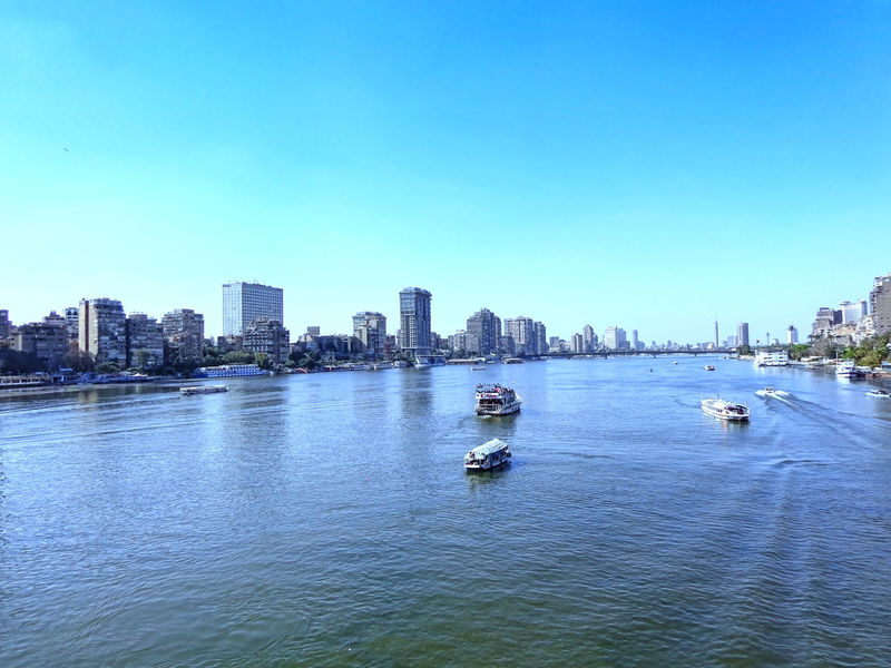 Blue Reflection Water City Sky Architecture Building Exterior Nature Outdoors Cityscape Built Structure Clear Sky Nautical Vessel No People Urban Skyline Beauty In Nature Day Skyscraper The Nile River