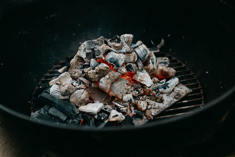 High angle view of fire on barbecue