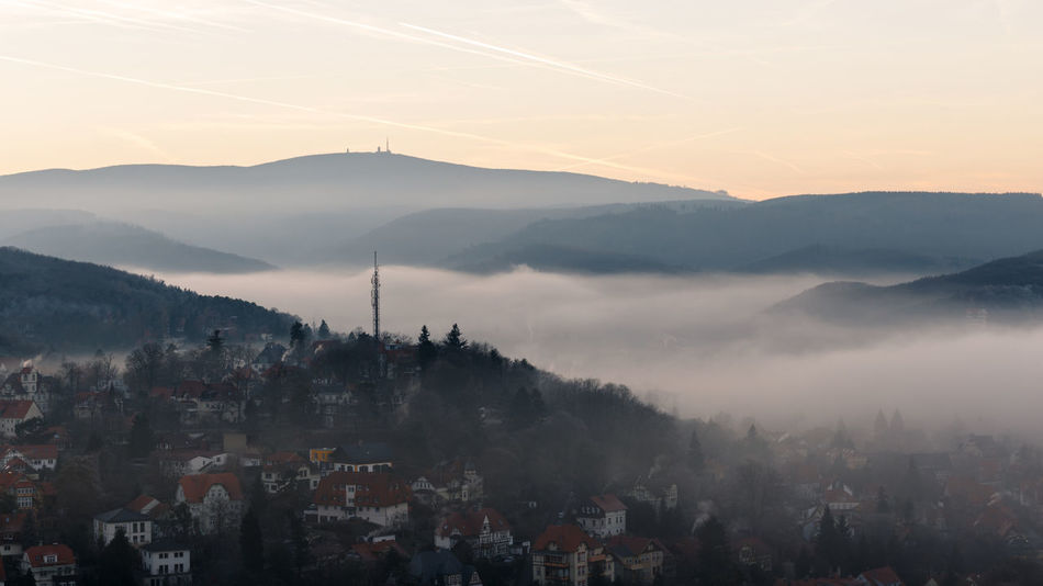 Sky Building Exterior Mountain Architecture Built Structure City Fog Nature Beauty In Nature Sunset Scenics - Nature Mountain Range No People Building Cityscape Sun High Angle View Environment Residential District Outdoors TOWNSCAPE Brocken Harz Harzmountains Wernigerode