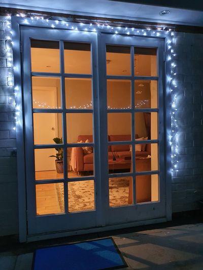 Illuminated building seen through glass window