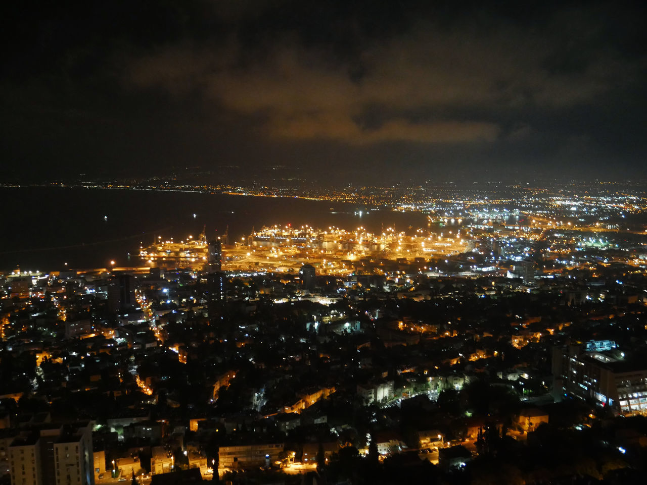 night, illuminated, city, cityscape, architecture, building exterior, built structure, sky, no people, cloud - sky, nature, building, outdoors, aerial view, high angle view, opportunity, positive emotion, modern