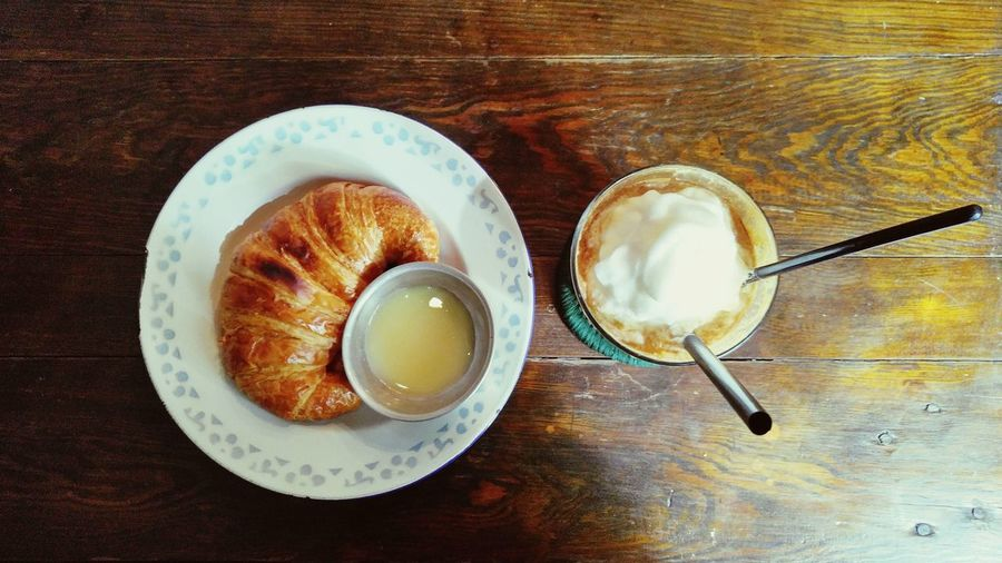 Directly Above View Of Whipped Cream Coffee With Croissant On Table