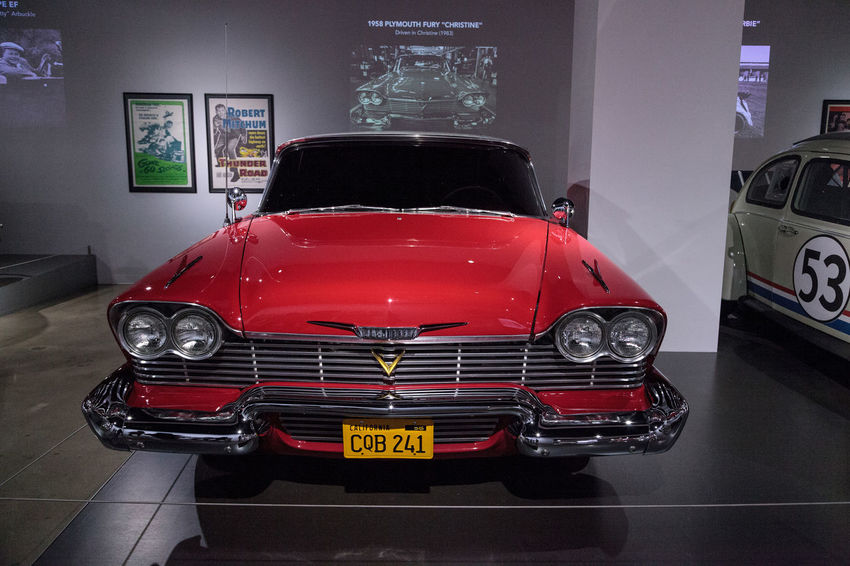 Los Angeles, CA, USA - March 4, 2017: Red 1958 Plymouth Fury stunt car from the movie Christine from the collection of Martin Sanchez at the Petersen Automotive Museum in Los Angeles, California, United States. Editorial only. 1958 Antique Christine Classic Car MOVIE Movie Prop Old Car Petersen Automotive Museum Plymouth Plymouth Fury Stunt Car Transportation Vintage Vintage Cars