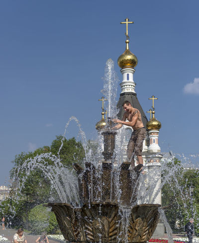 Russia, Yekaterinburg, fountains, heat, youth Architecture Blue Built Structure Capital Cities  City Culture Day High Section Low Angle View Modern Nature No People Outdoors Russia, Yekaterinburg, Fountains, Heat, Youth Sky Tall - High Tourism Travel Destinations