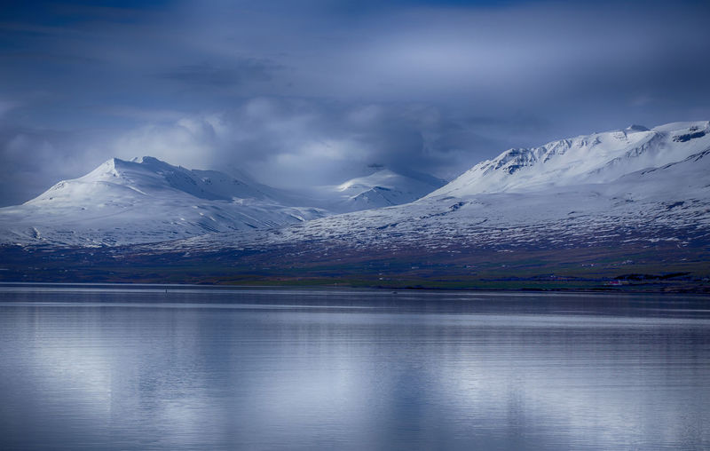 Shoreline near Akureyri in Iceland Iceland Akureyri Beauty In Nature Cold Temperature Day Environment Frozen Glacier Ice Iceberg Lake Landscape Mountain Nature Outdoors Reflection Scenics Shoreline Sky Snow Snowcapped Mountain Tranquil Scene Tranquility Water Winter