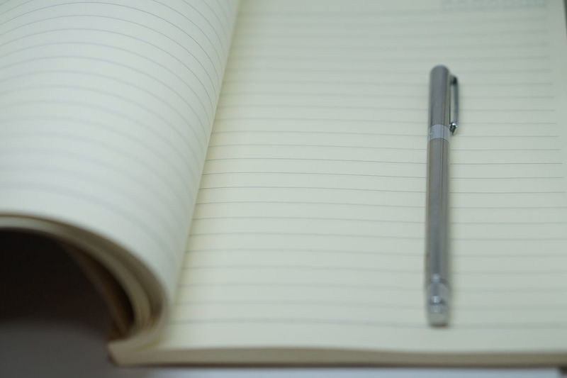 Close-up of pen on open book