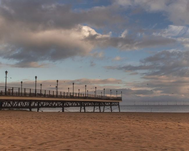 Skegness Pier Sky Cloud - Sky Beach Sea Water Land Sand Architecture Nature Scenics - Nature Beauty In Nature Built Structure Pier Tranquility Horizon Tranquil Scene No People Travel Destinations Horizon Over Water Outdoors