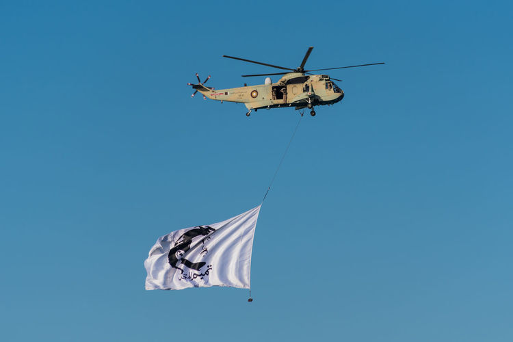 Doha Qatar National Day Air Vehicle Army Soldier Blue Clear Sky Day Flag Flying Helicopter Low Angle View Men Military Outdoors Patriotism People Qatar Sky