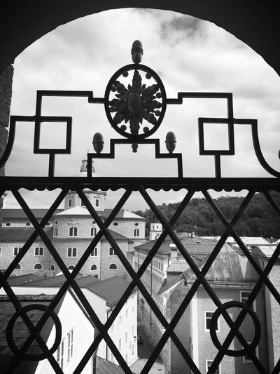 Sky Cloud Cloud - Sky Geometric Shape Day Architectural Feature City Life Rooftops Salzburg, Austria Beer Garden Wrought Iron Arch Window
