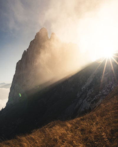 Sky Mountain Sunlight Beauty In Nature Sun Lens Flare Sunbeam Nature Scenics - Nature Tranquil Scene Tranquility Landscape Non-urban Scene Day Environment Cloud - Sky No People Mountain Range Land Outdoors Bright Mountain Peak Solar Flare