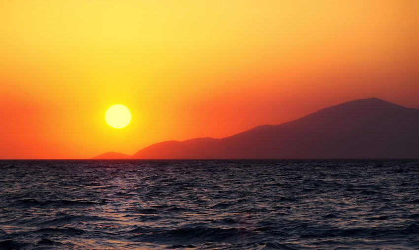 sunset over the sea and island in kos greece Kos, Greece Beauty In Nature Copy Space Greece Horizon Horizon Over Water Idyllic Island Kos Mountain Nature Orange Color Outdoors Romantic Sky Scenics - Nature Sea Seascape Sky Sun Sunset Tranquil Scene Tranquility Water Waterfront