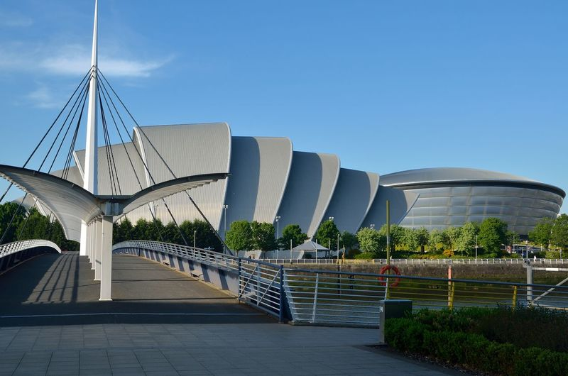 Glasgow Clyde Auditorium & SEC Hydro Sky Architecture Built Structure Nature Building Exterior Clear Sky Bridge Modern Day Bridge - Man Made Structure Connection No People Plant City Railing Water Blue Footpath Copy Space Outdoors Office Building Exterior Skyscraper Glasgow Hydro Glasgow Armadillo Glasgow Clyde Auditorium Armadillo