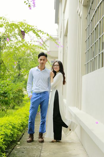 my classmate Graduation Ao Dai Vietnam Full Length Togetherness Women Smiling Bonding Men Standing Happiness Cheerful Love Arm In Arm Mature Couple Mid Adult Couple