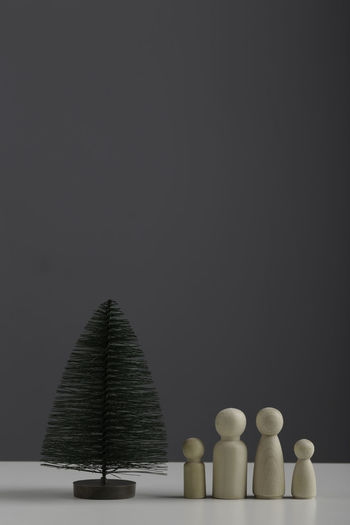 Close-up of stack on table against black background