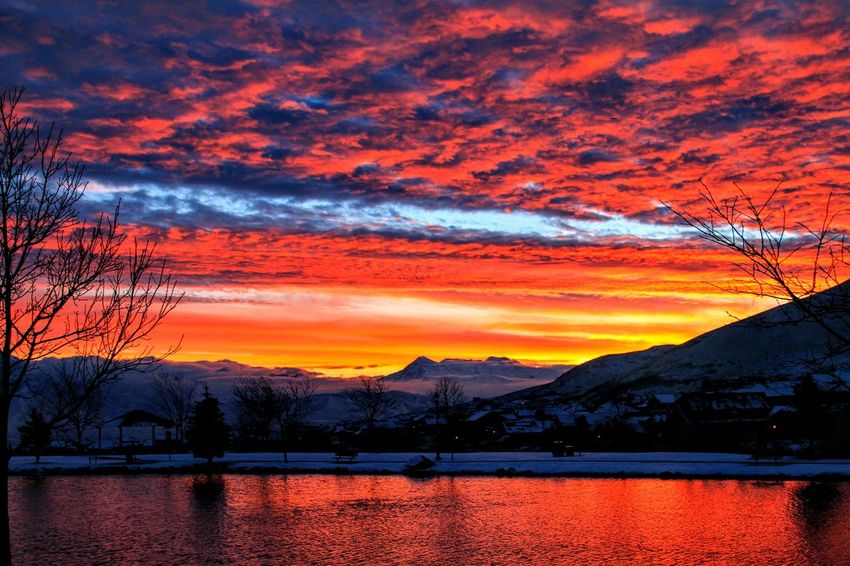 """""""Sunrise on the Lake"""" Sunset Orange Color Mountain Dramatic Sky Reflection Sky Scenics Nature Beauty In Nature Lake No People Outdoors Autumn Landscape Tranquility Cloud - Sky Water Tree Mountain Range Silhouette"""