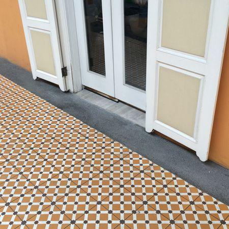 Vibrant shop front tiles Ground Wooden Detail Design Orange Texture Pattern Vintage Old Tiles Front Shop Shophouse Door Front Door Entrance House Architecture Building Exterior Doorway