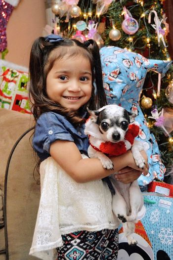 Looking At Camera Portrait Dog Pets Childhood Child Smiling One Animal Small Cute One Person Innocence Happiness One Girl Only Puppy Children Only People Cheerful Christmas Smile Detroit Innocence