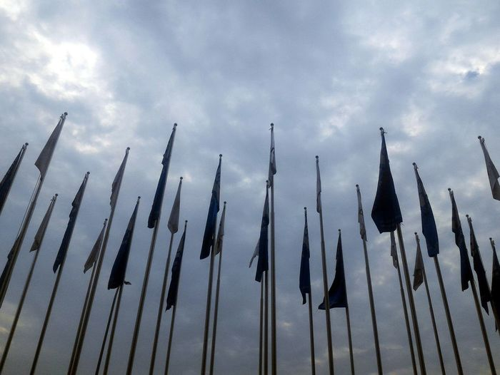 Line of Flagpoles.. Politics And Government Sky Cloud - Sky National Flag Flag Flag Pole Dramatic Sky Storm Cloud EyeEmNewHere